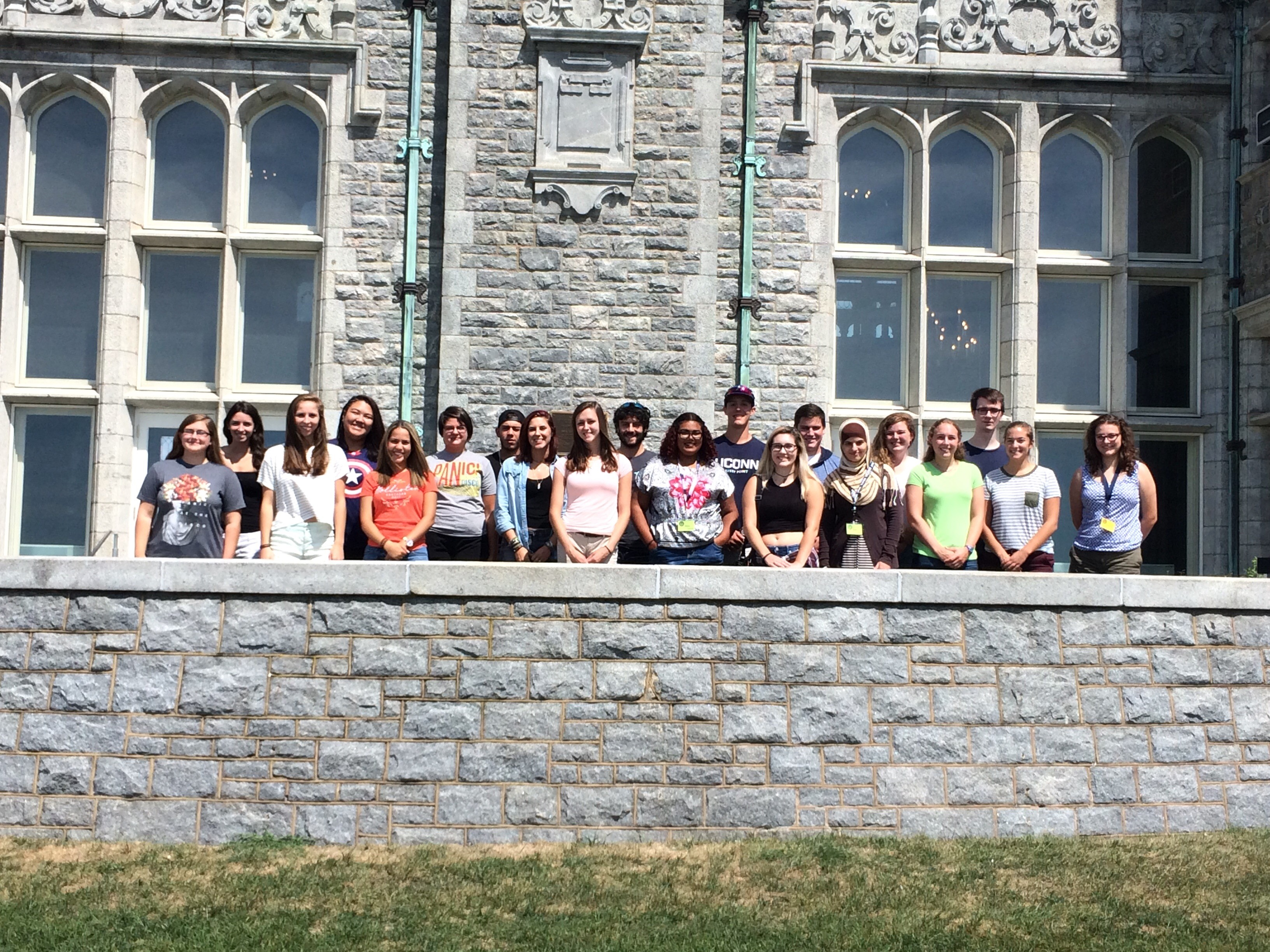 A group picture of the APAC staff on the patio of the Branford House